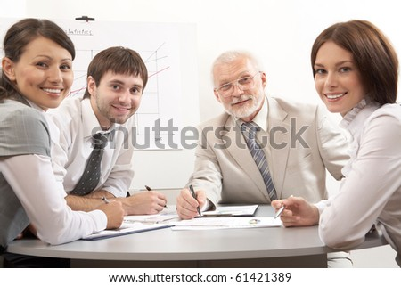 Business people at a meeting at office - stock photo