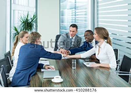 Business people at meeting in office - stock photo