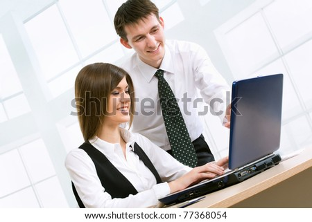 Business people at the office with a laptop