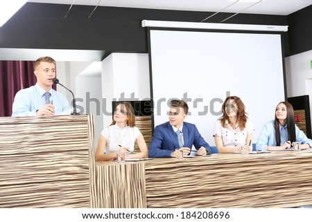 Business people at tribune in conference room - stock photo