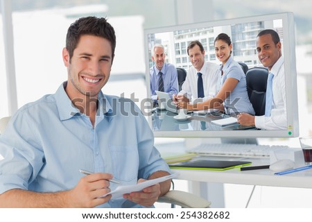 Business people brainstorming against handsome photo editor holding documents - stock photo
