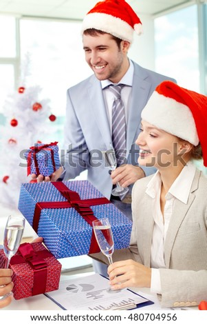 Business people celebrating Christmas in office