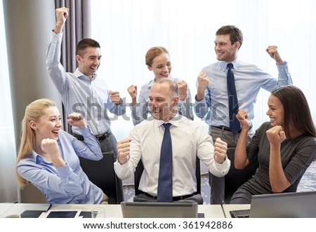 business people celebrating victory in office - stock photo