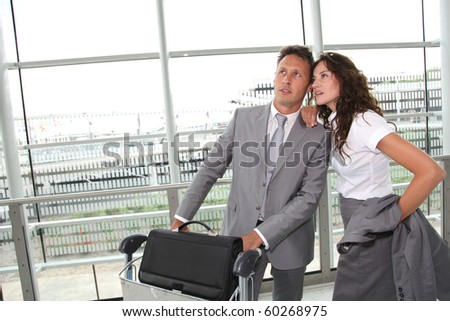 Business people checking flights at the airport - stock photo