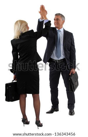 Business people clapping hands - stock photo