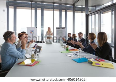 Business people clapping hands after successful meeting  in modern office. - stock photo