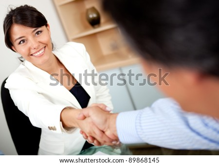 Business people closing a business deal with handshake