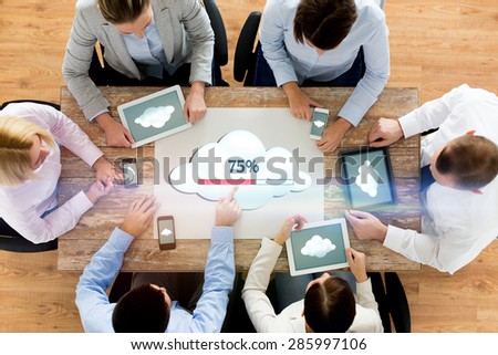 business, people, cloud computing and technology concept - close up of creative team with smartphones and tablet pc computers uploading data to server at office - stock photo