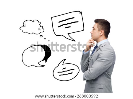 business, people, communication and information concept - thinking businessman in suit with text bubble doodles making decision