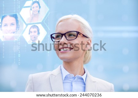 business, people, communication and technology concept - young smiling businesswoman and virtual screens with video chat outdoors - stock photo