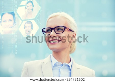 business, people, communication and technology concept - young smiling businesswoman and virtual screens with video chat outdoors