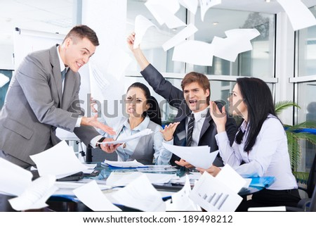 business people conflict problem, team working throw papers, documents fly in air,, businessmen and women serious argument negative emotion, businesspeople meeting at desk office - stock photo