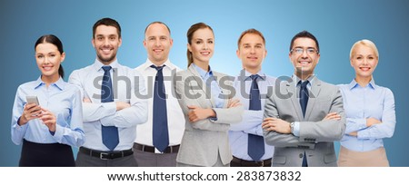 business, people, corporate, teamwork and office concept - group of happy businesspeople with crossed arms over blue background - stock photo