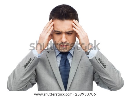 business, people, crisis and fail concept - businessman in suit having head ache - stock photo