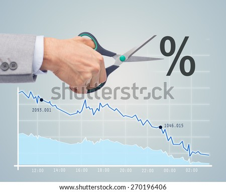 business, people, default, financial and economical crisis concept - close up of businessman hand with scissors cutting percentage sign over chart and gray background - stock photo
