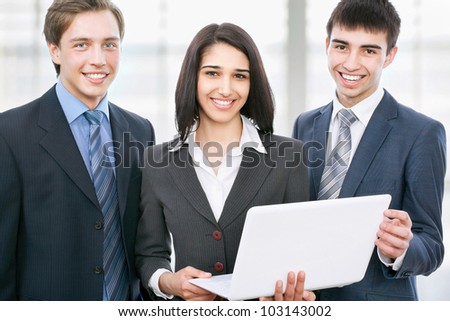 Business people discuss a new project inside modern office building - stock photo