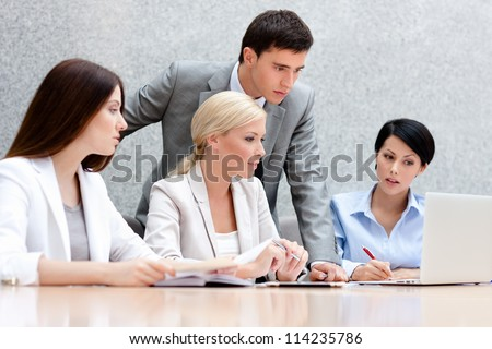 Business people discuss something at the meeting at the modern office building. Target achievement - stock photo