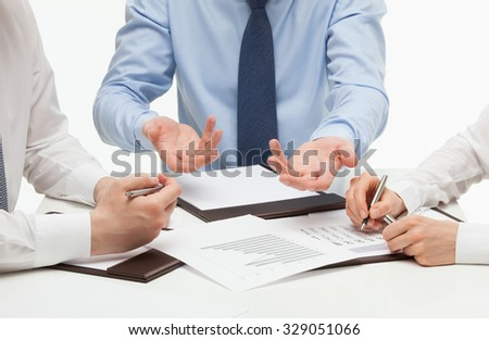 Business people discussing a new project, white background