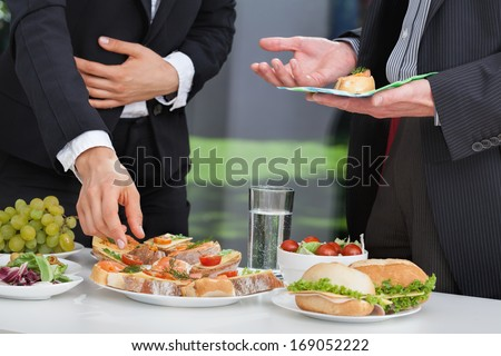 Business people discussing at the lunch buffet