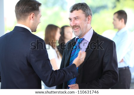 Business people discussing. Everyday setting - stock photo