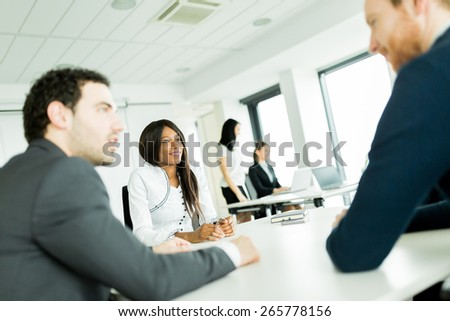 Business people discussing future plans and brainstorming at a white desk in an office