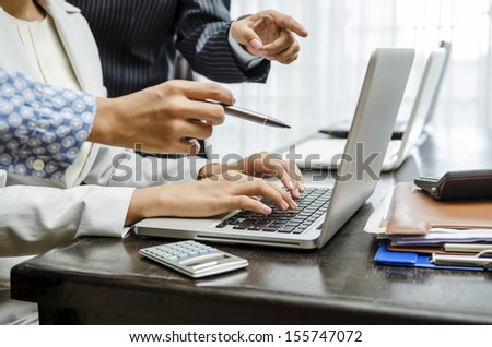 Business people discussing on laptop screen