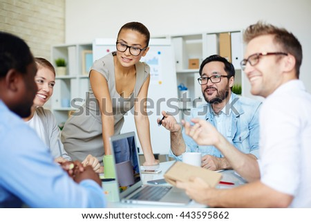 Business people discussing plans together during a meeting - stock photo