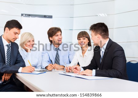 business people discussion on meeting, businessmen smile talking laughing, happy group businesspeople team sitting at desk in office, communicate - stock photo