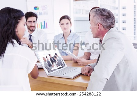 Business people disscussing a budget plan against business team discussing work details - stock photo