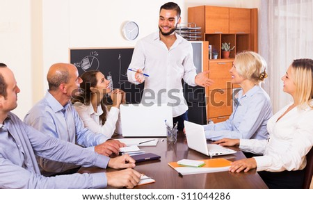 Business people during conference call indoors - stock photo