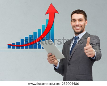 business, people, economics, technology and gesture concept - smiling businessman with tablet pc computer showing thumbs up over gray background and growth chart - stock photo