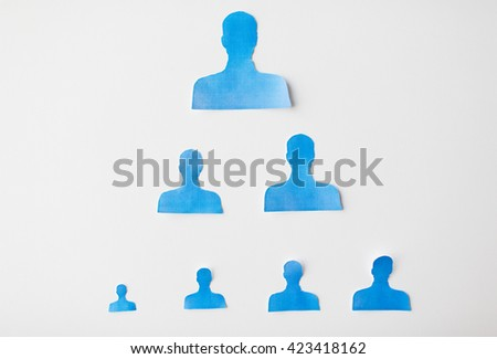 business, people, employment, career and hiring concept - close up of paper human shapes on white board - stock photo