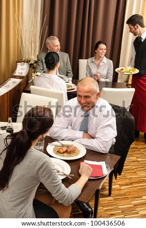Business people enjoy lunch meal at restaurant management discussion - stock photo