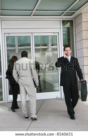 Business people entering and exiting the company - stock photo