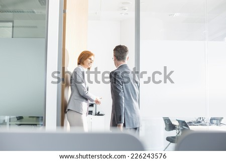 Business people entering into conference room - stock photo