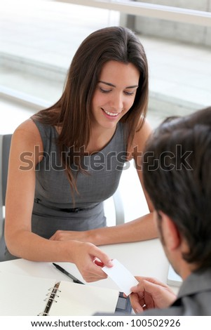 Business people exchanging business card - stock photo