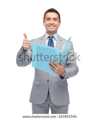 business, people, finances and paper work concept - happy smiling businessman in suit holding folder and showing thumbs up - stock photo