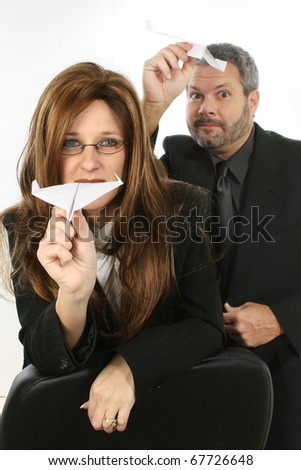 Business people flying paper airplanes. - stock photo