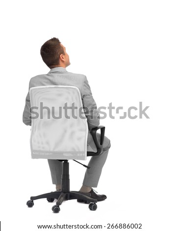business, people, furniture, rear view and office concept - businessman sitting in office chair from back - stock photo