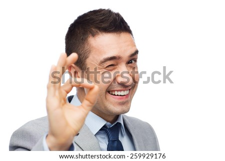 business, people, gesture and success concept - happy smiling businessman in suit showing ok hand sign - stock photo