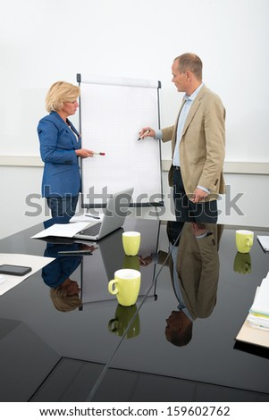 Business people giving a presentation - stock photo