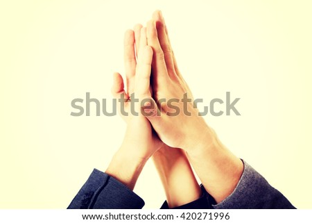Business people giving high five - stock photo