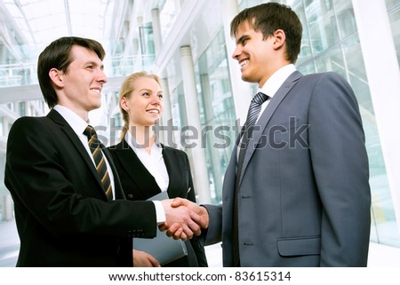 Business people greet each other a handshake