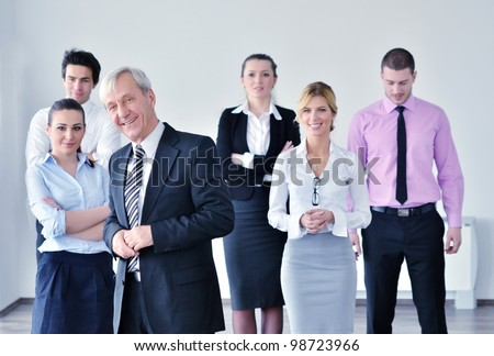 business people  group at a meeting in a light and modern office environment. - stock photo