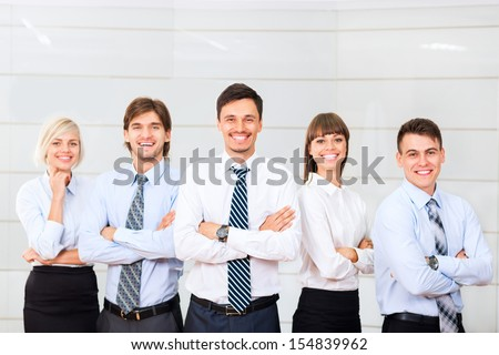 Business people group happy smile standing line at office, businesspeople row colleague team leader boss folded hands - stock photo