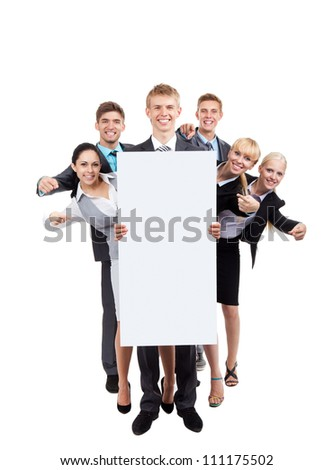 Business people group holding blank white card board, point finger showing empty signboard, young businesspeople standing together happy smile, full length portrait Isolated over white background