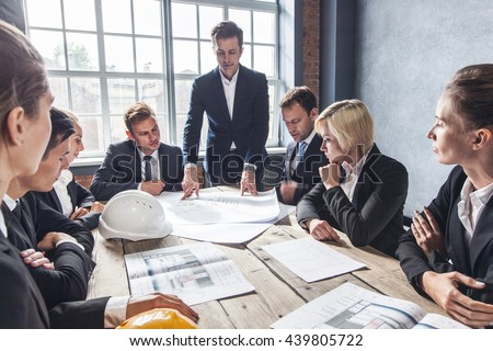 Business people group on meeting construction stock photo business people group on meeting with construction engineer architect looking building blueprint malvernweather Gallery