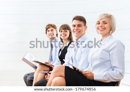 business people group smile sitting row, line in office meeting conference room, businesspeople interview with colleague, human resources - stock photo