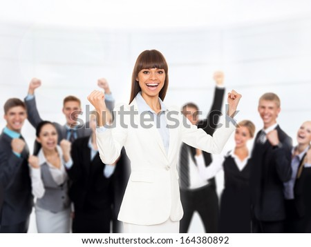 Business people group success team, woman raised arms hands up, businesspeople smile hold fist ok yes gesture in office