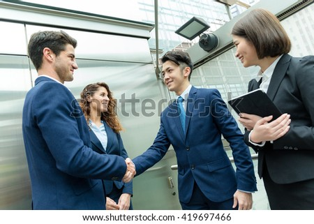 Business people hand shaking at outdoor - stock photo